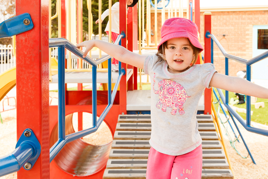 Child on outdoor climbing frame at Aussie Kindies Sunbury