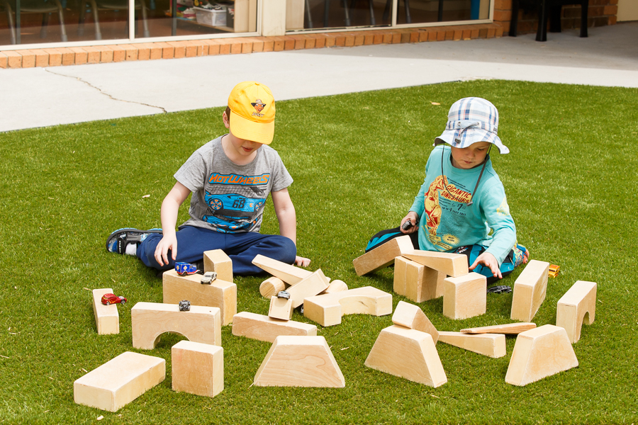 Children playing with wooden building blocks at Aussie Kindies Sunbury